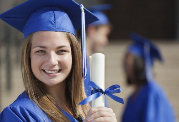 happy female graduate holding diploma
