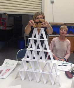 Woman testing her teams index card pyramid